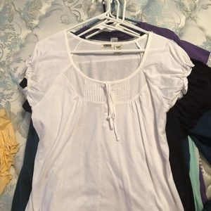 White top with ruffled cap sleeves. Never worn.